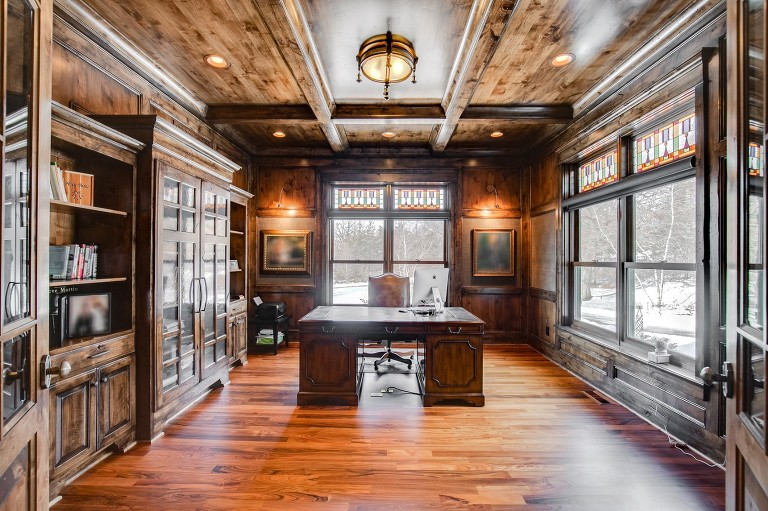 Photo of all wood paneled home office